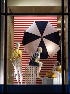 idea: parasol, striped background, white elevation tiers