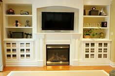 Built In Bookcases Around Fireplace | symmetrical built in bookcases flank a fireplace and flatscreen tv