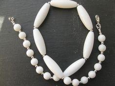 White jades rice beads with white quartz rounds.
