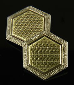 Elegant gold cufflinks from the golden Age of Jazz.  Intricately engine-turned yellow gold centers are surrounded by white gold borders decorated with bold geometric figures and stylized palmettes.  Crafted in 14kt gold,  circa 1925.