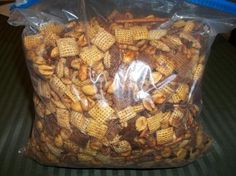 Texas trash using this cracker mix with the fire cracker spice :) package ranch dressing mix tbs red pepper flakes oil