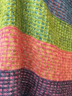 Free Knitting Pattern for 4 Row Repeat Pastille Baby Blanket - This colorful baby blanket is created with stripes of easy slipped stitch mosaic colorwork in in a 4 row repeat. Most Ravelrers rated this easy. Perfect use for stash yarn – you can make the stripes any size and colors you want. Great with multi-color yarn! 25″ x 29″ but you can customize to any size. Designed by Vickie Hartog. Pictured project by Tyek.