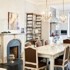 The New York City townhouse of Katie Lee Joel, ex-wife of musician Billy Joel. The couple purchased the home together in it was decorated by Nate Berkus, and it was sold by Katie Lee Joel in Home Design, Interior Design, French Dining Chairs, Dining Room Fireplace, Dining Room Design, Dining Rooms, Dining Area, Dining Table, Nate Berkus