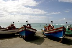 Fishing boats docked at the harbor in Arniston, a small fishing village near Cape Town. South Afrika, Marine Ecosystem, Boat Dock, Fishing Villages, Rowing, Pictures To Paint, Fishing Boats, Beautiful Beaches, Tourism