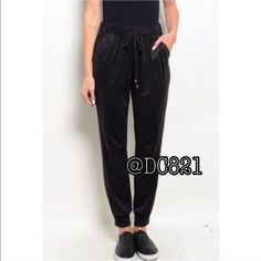 Black Jogger Pants Casual black joggers pant with elastic drawstring waist and 2 front pockets. Made of a soft velvety cotton/poly spandex blend. Size S, M, L true to size. Great basic staple to any wardrobe. Brand new without tags Pants Jumpsuits & Rompers