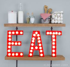 Need something ultra-cool for your cook space? Whip up theater-inspired letters that are guaranteed to light up a room. For an authentic salvaged look, try glossy spray paint. It reflects the light to mimic painted metal.