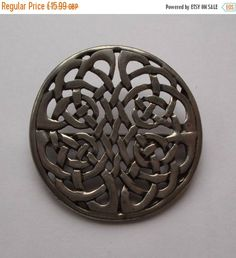 Summer Reductions Vintage 1970s Brooch Celtic Style Silver Tone Round Hape with Fretwork by vintageretrojewels on Etsy