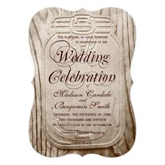 "Country Mason Jar Rustic Wood Wedding Invitations.    Matching Reply Cards  . Rustic Country Mason Jar Distressed Barn Wood Wedding Invitations with a die cut bracket shape.  These invites have a distressed canning jar design on a background of wood grain print.  The distressed barn wood print is also on the back of the invitation.  The rustic country wedding invite has the words ""Wedding Celebration"" in fancy script font.  The part of the design is part of the background and cannot be.."