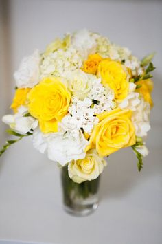 yellow and white roses, hydrangea, and fresias.