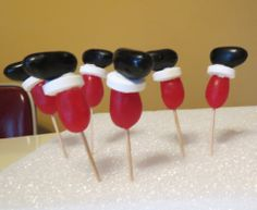 Santa leg cupcake toppers ~ Jumbo jelly beans (Wakarusa Dime Store) and life savers 'glued together' with frosting.  Just as cute as fondant, but easier.
