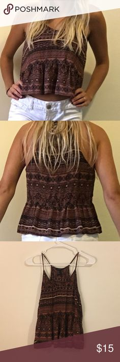 FOREVER21 flowy tribal racerback tank top FOREVER21 flowy tribal racerback tank top. In good condition, only worn a few times. Size medium but fits like a small. Shows a small bit of the stomach with low rise shorts. Forever 21 Tops Tank Tops