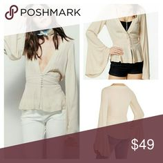 Free People Boho Bell Sleeve Top Free People Boho Bell Sleeve Top. Beige. Boho Bell sleeves adorn this groovy top from Free People featuring a V-neckline, button closure at front and a peplum hem. EUC   No Trade or PP  Offers Considered  Bundle discounts Free People Tops Blouses