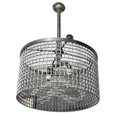 Factory conveyor belt grating fashioned into chandelier...yes, please.