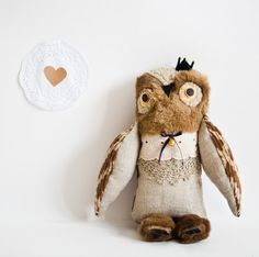 Prince Owl by Wassupbrothers on etsy, $70 :  http://www.etsy.com/listing/92744873/prince-owl