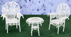White Wire Fairy Garden Patio Table and 2 Chairs  http://www.efairies.com/store/pc/White-Wire-Fairy-Garden-Patio-Table-and-2-Chairs-245p1321.htm  $31.99