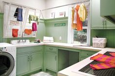 I would love this laundry room. This high-functioning laundry room is decked out in vintage green paint to unify the custom cupboards below and the beadboard above. Clothes Drying Racks, Hanging Clothes, Laundry Room Storage, Laundry Rooms, Laundry Rack, Laundry Room Inspiration, Hanging Racks, Hanging Bar, D House