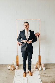 Eye-Catching Tassel Backdrop in this Modern Boho Wedding Inspiration #weddingceremonybackdrops #industrialweddingvenue #midwestbohobridalstyle