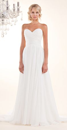A soft strapless gown in flowy chiffon with a sweetheart neckline and ruched bodice. Shown in Pearl and also available in Cream Pearl.