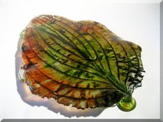The Fall is here.. Big leaf-platter with 4 legs - stands perfectly stable..   Casted with Bullseye art glass.. glasspowders & frits..  Makes lovely color reflections when the light hits it.. and it shimmer nice because of the Green/Blue Aventurine in this glass.. :-)