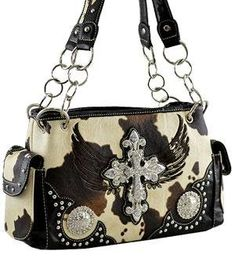 Cross Wing Shoulder Bag w/Rhinestone HANDBAG - BLACK. 13(L) x 8.5(H) x 4.5(W) & Metal feet on bottom. Cow skin pattern faux leather & Zip top closure snap. Split Compartment with Mid Zipper Pocket & Double Handles w/Studs have a 9″ drop. One Wall Zipper and Two Pouch Pockets Inside & Both Side Flap Pockets w/Magnetic Snap. 7″ Back Zip Pocket and 3.5 open pocket & Fabric Lining.