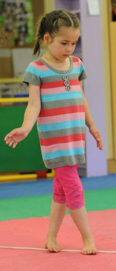 Pretend you are walking the tight rope, or walking like a crocodile in the water. Great indoor or outdoor fun!