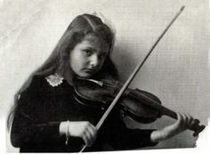 Alma Rosé (1906-1944) was an Austrian violinist of Jewish descent. Her uncle was the composer Gustav Mahler. She was deported by the Nazis to the concentration camp at Auschwitz-Birkenau. For ten months, she directed an orchestra of prisoners who played as prisoners went to work and then when they returned home. She's aged 14 in the pic. She died, aged 37, of a sudden illness at the camp, possibly food poisoning.