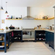 Overview of bespoke kitchen showing open storage and polished concrete worktops cast in situ