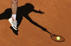 The shadow of the French tennis player Richard Gasquet, during a match during the 1000 Tennis Masters Roma (Italy), May 14, 2013.