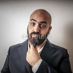 elegant bearded man with jacket and funny expressions $200