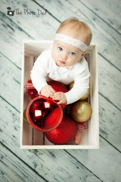 Baby Christmas picture in crate with ornament decoration balls.  Copyright 2013 ThePhotoDad.com Josh@ThePhotoDad.com 701.541.2791 Fargo, ND Child&Family Photography