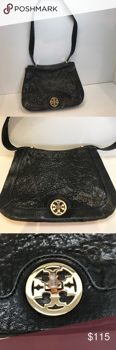 Tory Burch Shoulder Bag Classic black pebbled leather Tory Burch bag. Exterior in excellent condition. Some wear to signature symbol clasp due to use but does. It take anything away from this beautiful bag. Tory Burch Bags Shoulder Bags