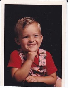 Vintage Photo of a Very Cute Young Boy Blonde Hair Bright Eyes Cute Smile wearing Overalls and a Red Shirt.  This is an Original Snapshot Photograph from the 1980s Old Color Art Picture.  Find more Vintage Photos in our Etsy Shop @ http://ljpsales.etsy.com  #VintagePhotos #ColorPhotos #PortraitPhotos #cute #young #boy #1980s