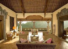 Entry is via the traditional Balinese gate-way protected by stone guardians. Antique Javanese doors open onto the main living area. Designed by Balinese Architect Ida Bagus Wyadnyana.