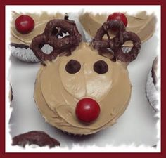 Reindeer Cupcakes    Red peanut butter M's for the nose  Chocolate chips and blue mini M's for the eyes  Chocolate covered pretzels for the antlers  One container of ready made vanilla frosting mixed with brown food coloring