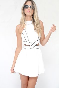very much in love with this cutout white dress