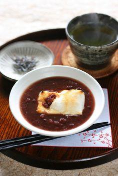 Zenzai (sweet azuki bean soup and grilled rice cake) by bananagranola (busy), via Flickr. | Azuki bean jam, water, a little salt, rice cake, shio-kombu (garnish).