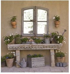 Beautiful potting table. Note window, mount on a big blank garage wall w mirror to reflect garden.
