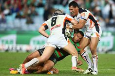 Geoff Lima of the Rabbitohs is tackled during the round 10 NRL match between the South Sydney Rabbitohs and the Wests Tigers at ANZ Stadium on May 17, 2013 in Sydney, Australia.