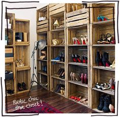 Recycled wooden crates stacked to create a shelving system have been cleverly used as shoe storage in this bedroom. The dark wooden floor and traditional red rug add to the vintage feel. - LOVE this idea for shoe storage!