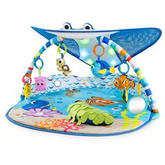 Mr. Ray Ocean Lights Activity Gym from Bright Starts. Welcome aboard, explorer! Let baby pal around with Mr. Ray, Nemo, and friends from the film favorite Finding Nemo. Features a captivating canopy with lights, 20+ minutes of ocean-themed melodies, six detachable take-along toys including a Dory finger puppet, self-discovery clamshell mirror, Squirt rattle, Nemo bead chaser, tug-able Pearl the octopus, and sand dollar teether, plus a prop pillow for tummy time.