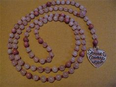 6mm Rose Quartz and Rhodonite, Hand Knotted on Maroon Silk with a Serenity Charm, created by Mother Earth Malas