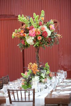 Tall centerpieces allow for more room on table for banquet style dining
