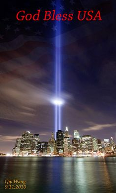 "God Bless USA    My homage to those that lost their lives or loved ones on September 11 2001.    May god protect and bless us all.    ""For the flag still stands for freedom, and they can't take that away"" ~ 9/11 Tribute in Light 88 searchlights placed next to the site of the World Trade Center create two vertical columns of light in remembrance of the September 11 attacks.