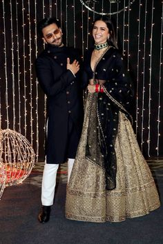 Ranveer Singh and Deepika Padukone coordinate in black and gold outfits Wedding Dresses Men Indian, Indian Bridal Outfits, Indian Fashion Dresses, Indian Designer Outfits, Deepika Padukone Style, Deepika Padukone Lehenga, Lehenga Designs, Mehndi Designs, Couple Outfits