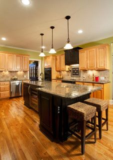 New Providence Lane Kitchen - traditional - kitchen - charlotte - by Case Remodeling- oak cabinets with multi color flooring.