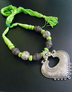 Oxidized pendant in green thread