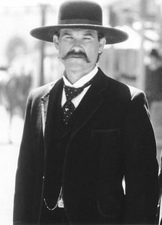 Every town has a story. Tombstone has a legend. Kurt Russell as Wyatt Earp in Tombstone.