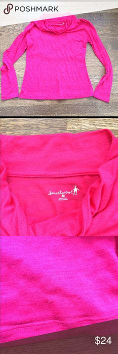 Smartwool medium pink pullover shirt Women's Smartwool shirt. Drape neck. Pretty pink color. Small snag in fabric as shown in picture three. Hardly noticeable. Pretty pink color Smartwool Tops Tunics