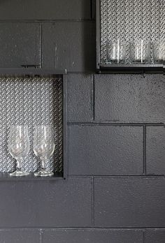 The final reveal! Dark charcoal paint, Dulux Titirangi teamed with recycled drawer shelves lined with 'metal tread' wallpaper from the Intenze range by Aspiring Walls. Decorating products are available in New Zealand through Guthrie Bowron stores.