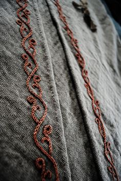 viking handcraft, gorgeous embroidery detail in chain stitch. viking handcraft, gorgeous embroidery detail in chain stitch. I'd love to sew this into Embroidery Techniques, Embroidery Stitches, Embroidery Patterns, Hand Embroidery, Sewing Patterns, Chain Stitch Embroidery, Border Embroidery, Indian Embroidery, Clothing Patterns